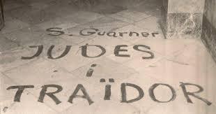 Pintada antisemita dels anticatalanistes a l'entrada del domicili de Sanchis Guarner durant la Transició.
