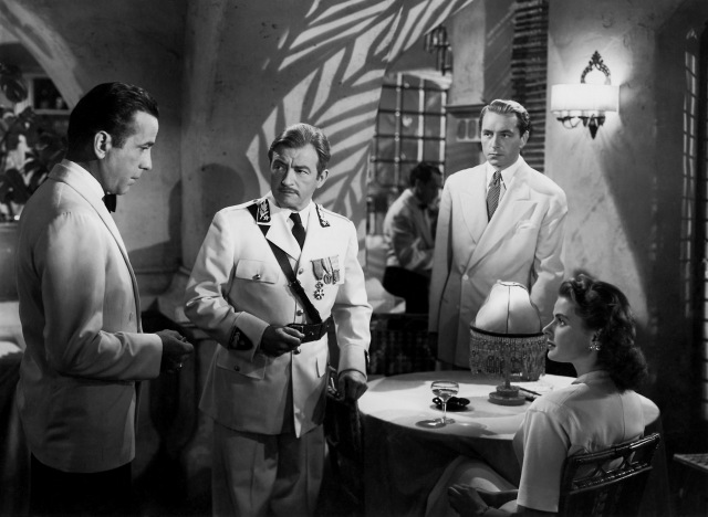 "A scene still from the 1943 Academy Award®-winning film ""Casablanca"" features (l to r) Humphrey Bogart, Claude Rains, Paul Henried and Ingrid Bergman.  Bogart received an Academy Award nomination in the Lead Actor category while Claude Rains was honored with a nomination in the Supporting Actor category.  ""Casablanca"" received eight Academy Award nominations in total and won three Oscars® including Best Picture. Restored by Nick & jane for Dr. Macro's High Quality Movie Scans Website: http:www.doctormacro.com. Enjoy!"